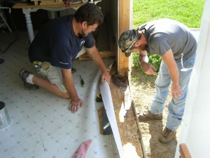 Contractors working on my rotten door frame
